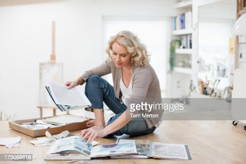 Woman with photograph album and scrapbook : Stock Photo