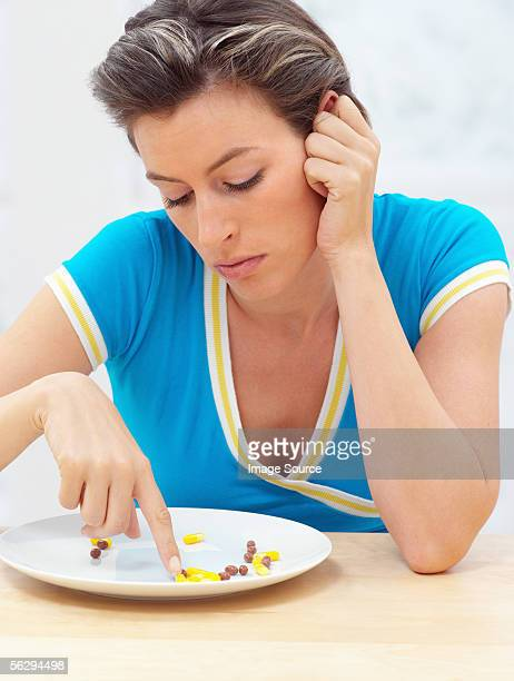 Woman with pills on a plate