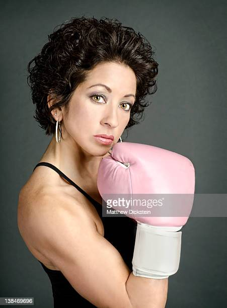 Woman with pink boxing glove