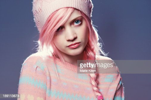 Woman with pink hair, hat, and sweater : Stock Photo