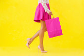 Woman with pink shopping bag