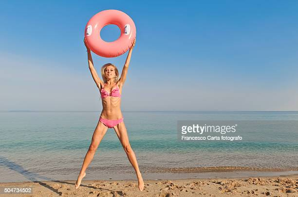 Woman with Pink Swimming Ring