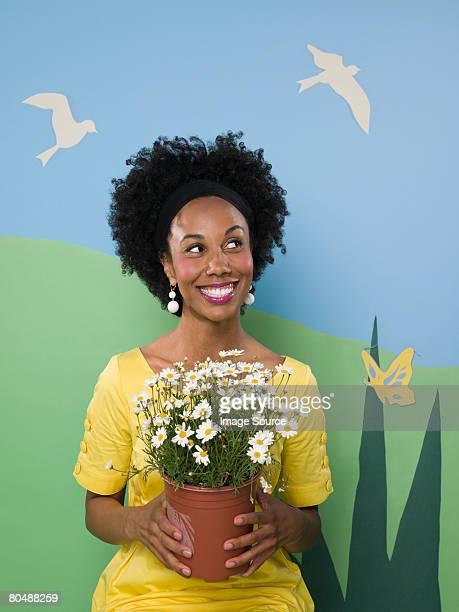 Donna con pianta