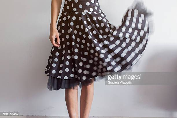 woman with polka dot dress in movement