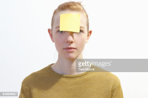woman with post-it note stuck to forehead