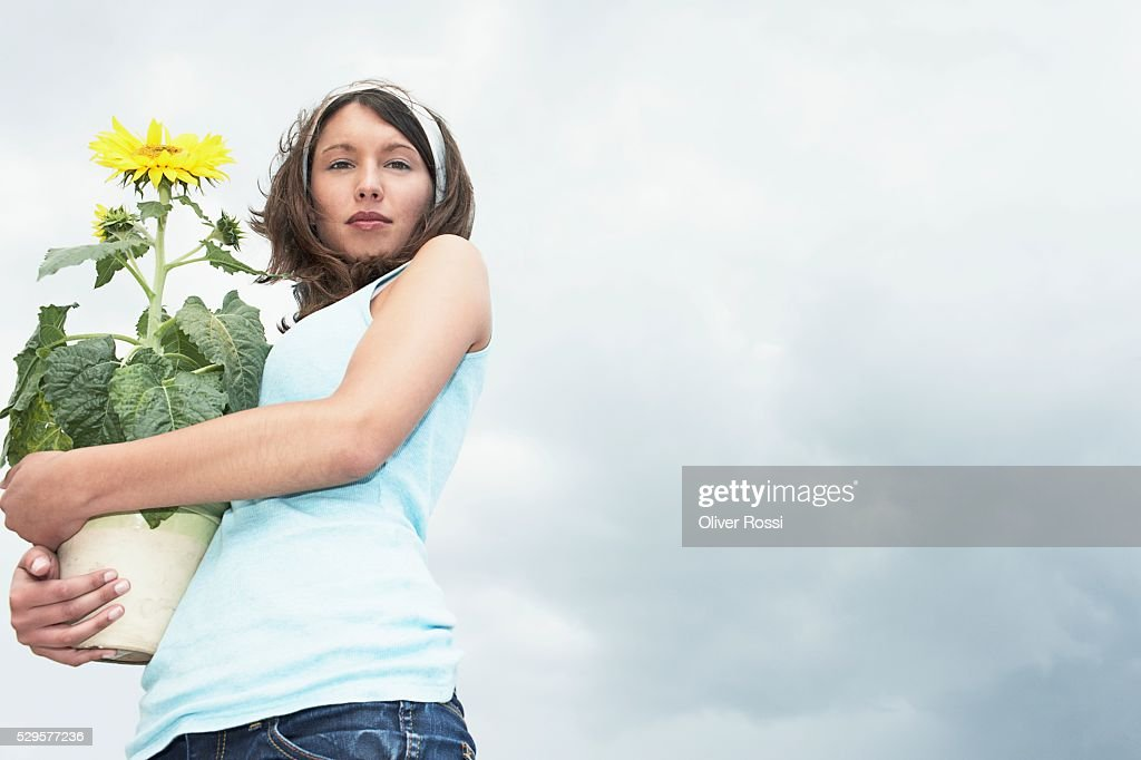 Woman with Potted Plant : Stock-Foto