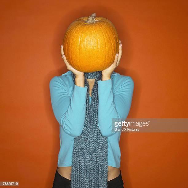 Woman with pumpkin