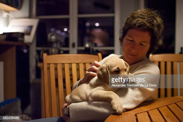 Woman with puppy Labrador dog
