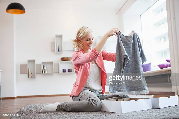Woman with purchase at living room