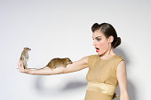 Woman with rats on her arm