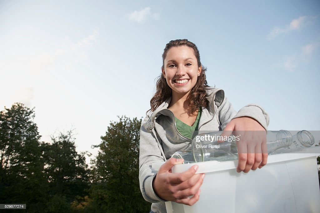 Woman with Recycling Bin : Bildbanksbilder