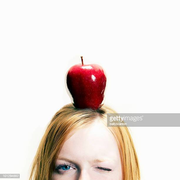 Woman with red apple on head, portrait