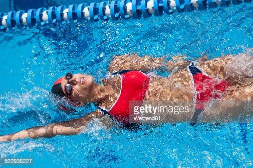 Swimming Pool Identification : Woman with red bikini swimming in pool stock photo getty