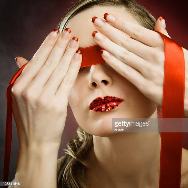 Woman with red blindfold