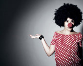 Woman with red clown nose and red polka dot tshirt