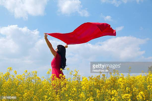 Woman with red dress and scarf in canola field (XXXL)