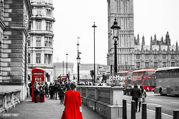 Woman with red dress in London selection color.