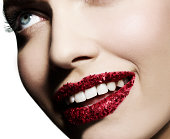 Woman with red glitter on her lips