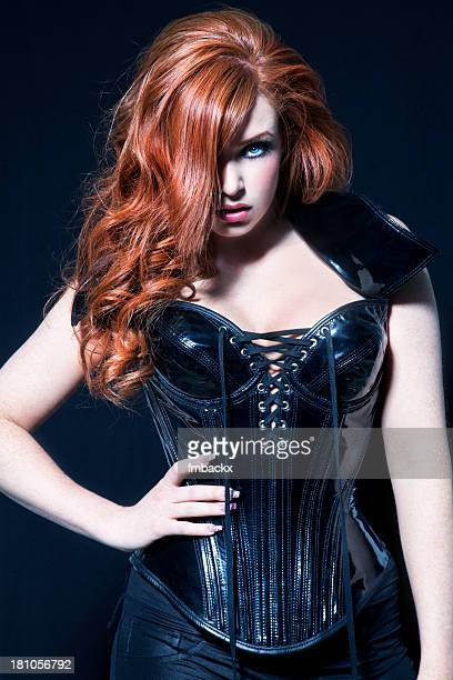 Woman With Red Hair And Black Corset