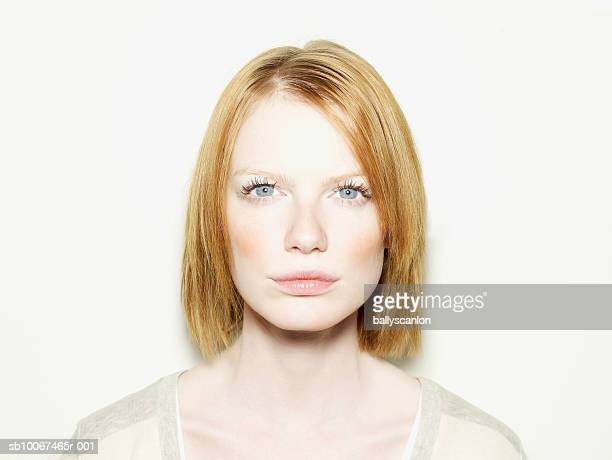 Woman with red hair, portrait, studio shot