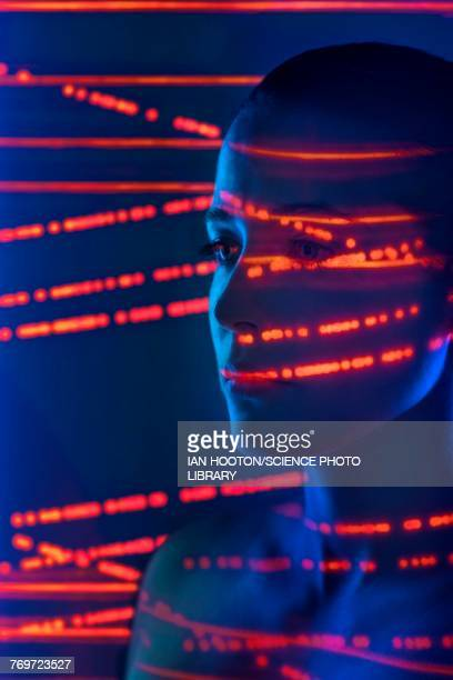 Woman with red lights on face