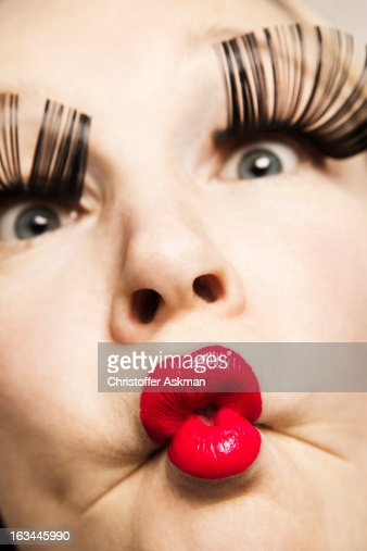 woman with red lips and big eyelashes : Stock Photo