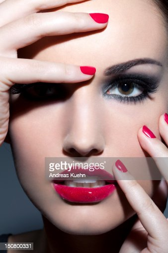 Woman With Red Lips And Nails Close Up Stock Photo
