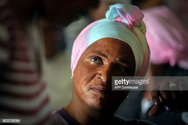 A woman with red paint on her face attends a commemoration under theme of unity in action marking the 50th anniversary of the death of late Chief...