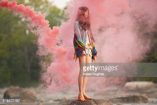 woman with red smoke around her : Stock Photo