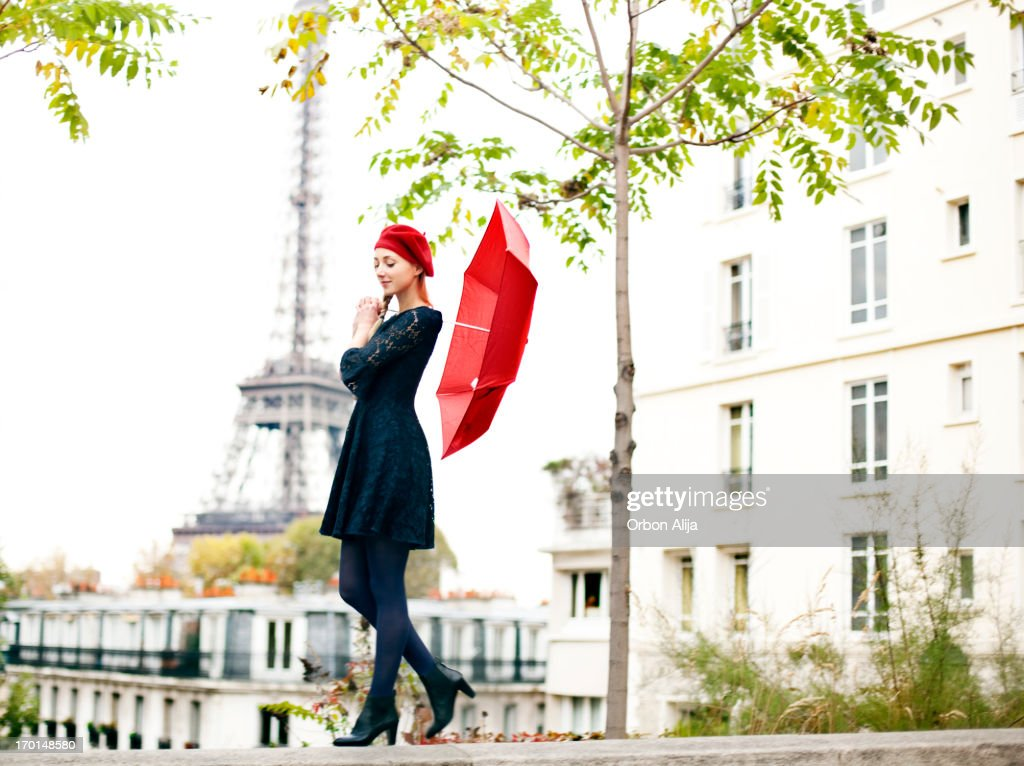 Woman with red umbrella near Eiffel Tower