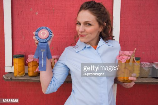 Woman with ribbon and preserves : Stock Photo