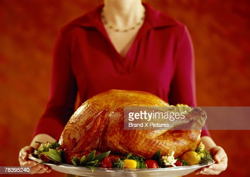 Woman with roast turkey