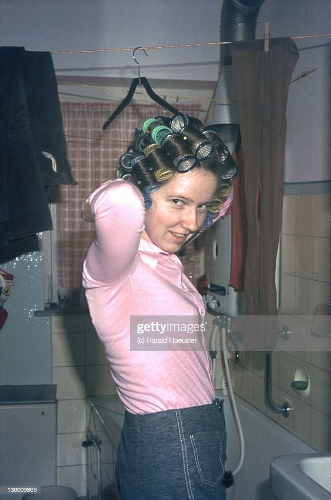 Woman with rollers in hair : Stock Photo
