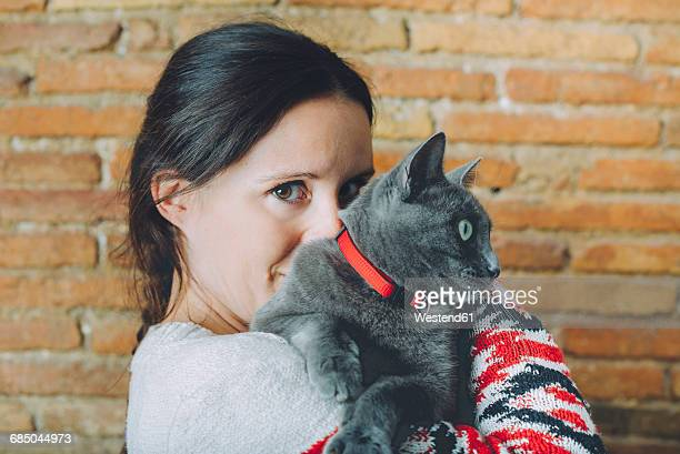 Woman with Russian Blue on her shoulder