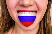 Woman with russian flag on the tongue - learning a foreign language