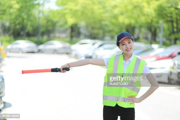 Woman with safety vest and safety rod
