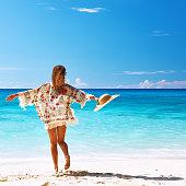 Woman with sarong on beach Anse Intendance at Seychelles, Mahe
