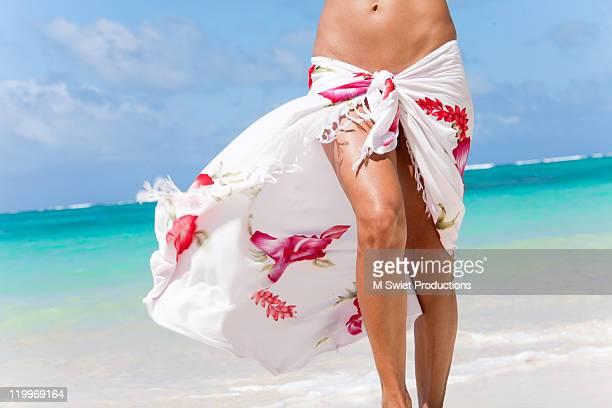 Woman with sarong on tropical beach