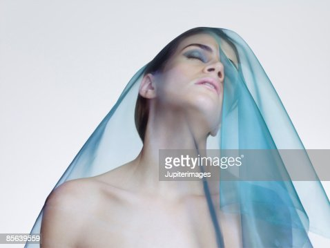 Woman with scarf draped over her head : Stock Photo