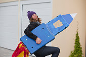 Woman with selfmade rocket, smiling