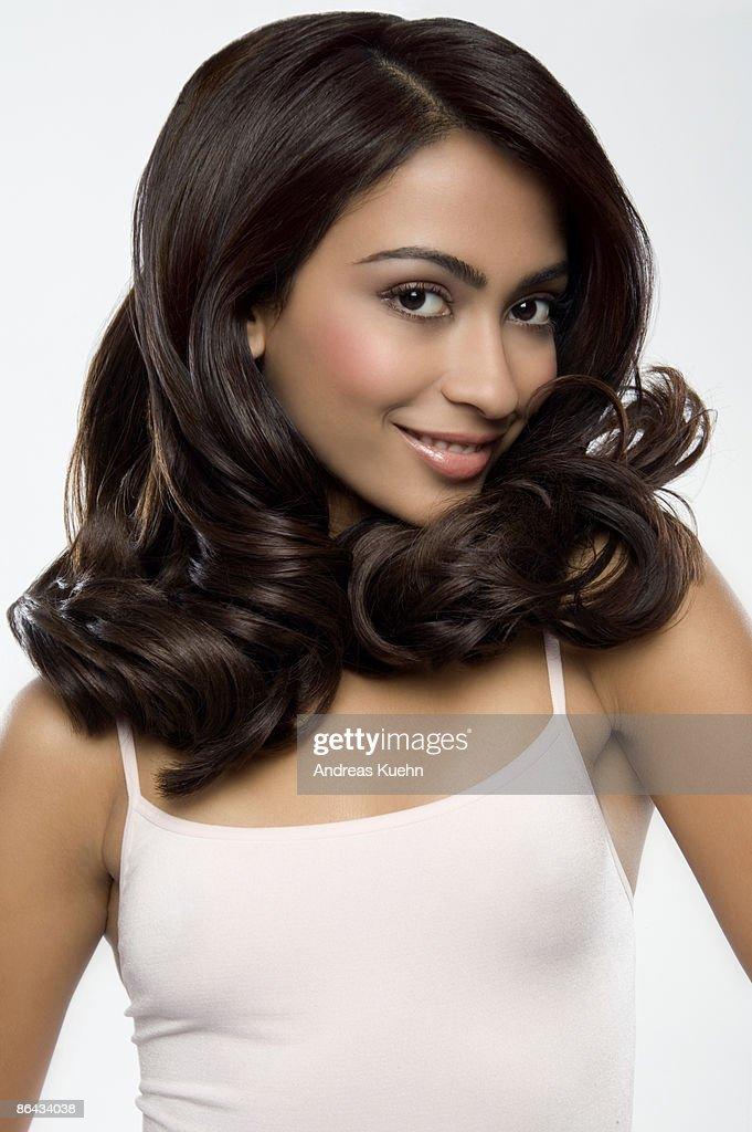 Woman with shiny dark hair, portrait. : Stock Photo