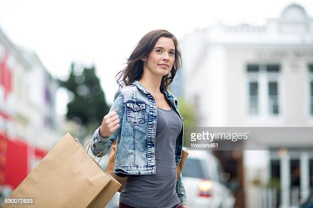 Woman with shopping bag walking on the street