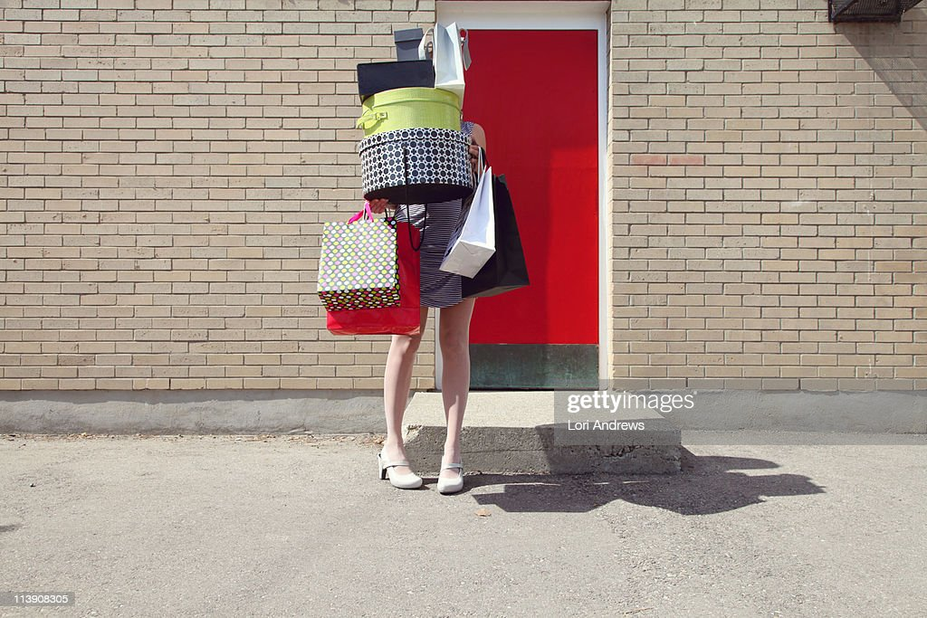 Woman with shopping bags and boxes : Stock Photo