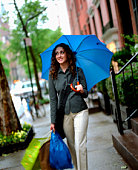 Woman with shopping bags and umbrella
