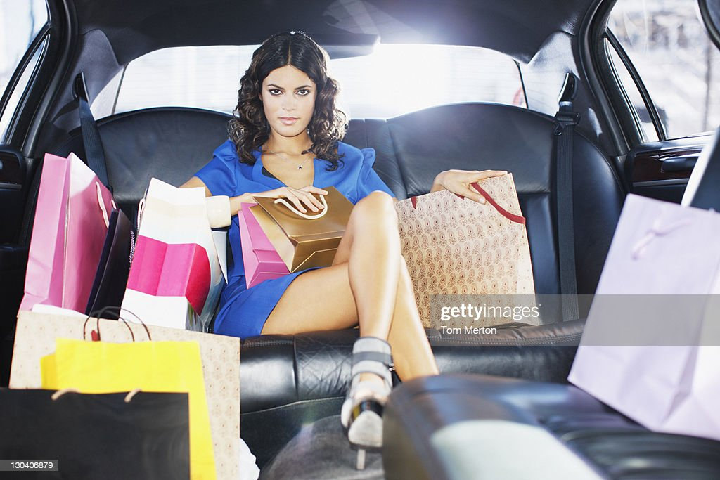 Woman with shopping bags in limo : Stock Photo