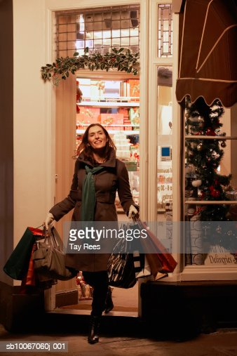 Woman with shopping bags, smiling : Stock Photo