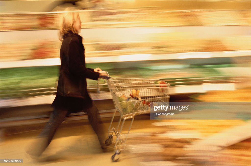 Woman with Shopping Cart : Stock Photo