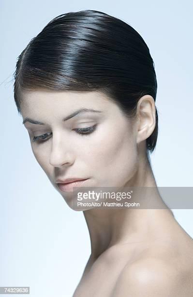 Woman with short hair, bare shoulders, portrait