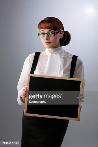 Woman with small blackboard : Stock Photo