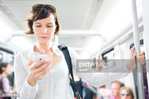 Woman with smartphone in subway
